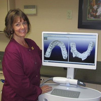 Our Dental Assistant Diana works with an actual patient to show her digital X-Rays.
