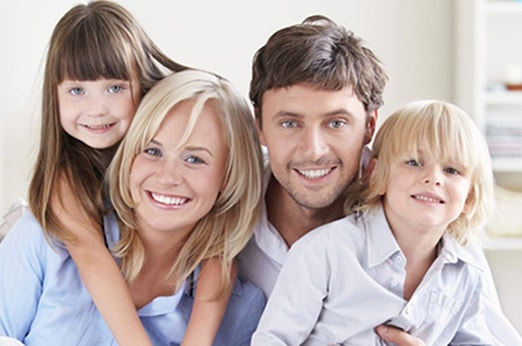 A smiling family illustrates the Premier Family Care we give our patients at our Redmond dental practice.