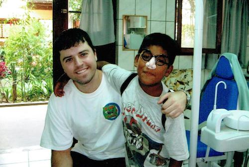 Dr. Frost with a young patient in Bolivia on his travels with International Smile Power