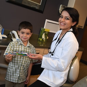Dr. Urvi Ruparelia works with a young patient at our Redmond Family Dentistry practice.