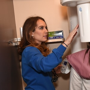 Chelsea, a dental hygienist at Frost Family Dental, uses our digital X-Ray machine.