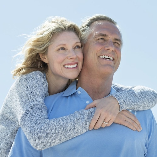 An older couple embracing and smilng to show our all-inclusive dentistry at Frost Family Dentistry in Redmond, WA.