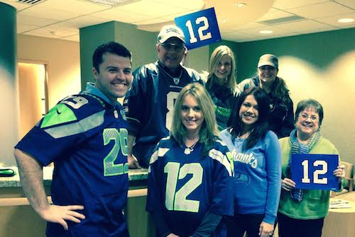 Our team in Redmond dressed in our 12th man gear to support the Seattle Seahawks. Go Hawks!
